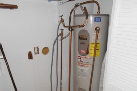 Hot water tank in utility closet