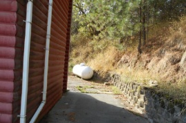 West side of home and propane tank