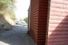 West side of home (back of bedroom)