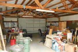Interior of shop (insulated, concrete floor and electrical, garage door opener)