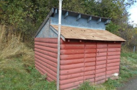 Well house on property with pressure tank, etc.